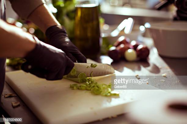 vegetable chopping - kitchen knife stock pictures, royalty-free photos & images