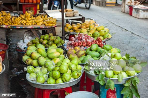 vegetable for sale in outdoor market - loofah stock photos and pictures