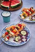 vegetable kebab with flatbread cucumber salad