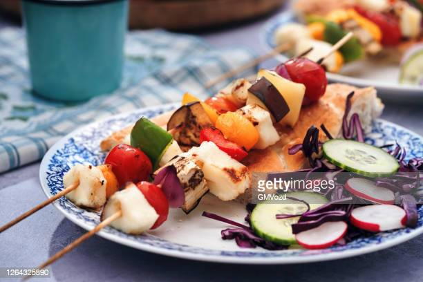 vegetable kebab with flatbread and cucumber salad - vegetable kebab stock pictures, royalty-free photos & images