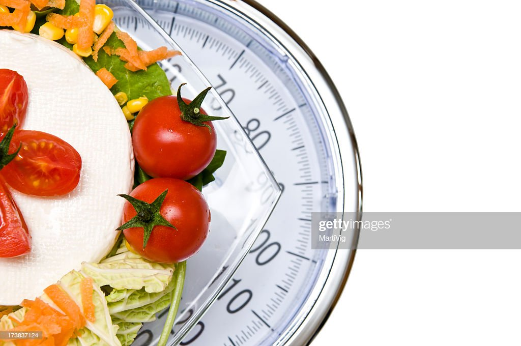 A vegetable platter on top of a scale : Stock Photo