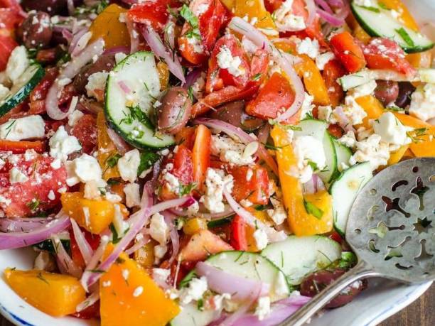 Vegetable salad with cheese in plate