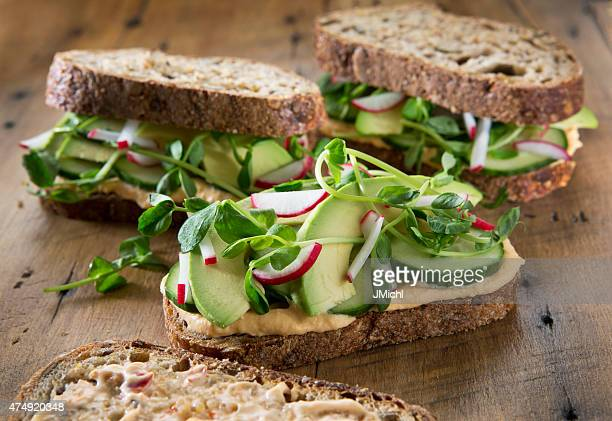 vegetable sandwich's on a rustic wood background. - vegetarian food stock pictures, royalty-free photos & images