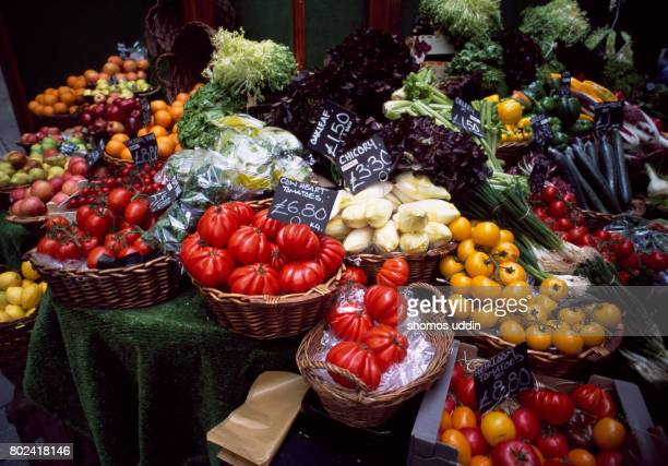 vegetable selections at market stall - borough market stock pictures, royalty-free photos & images