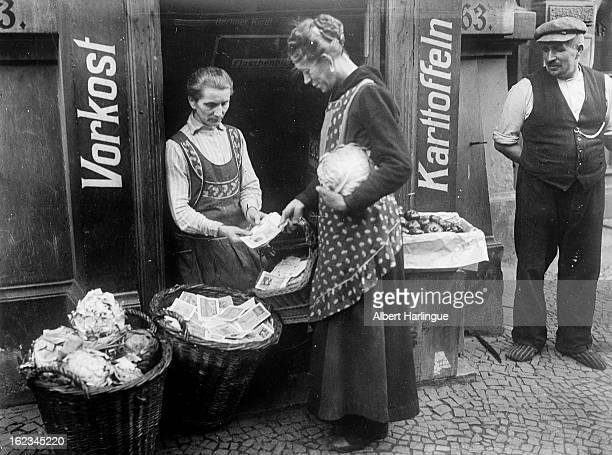 Vegetable seller during an economic crisis Weimar Republic circa 1919