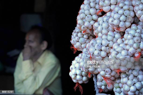 Vegetable seller waits for the customers at a market in Mumbai on March 26, 2009. Inflation in India edged closer to zero, official data showed,...