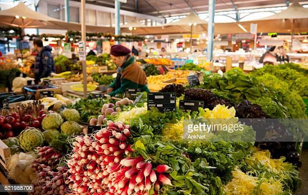 Vegetable stand at Les Halles farmer's market in Dijon, France