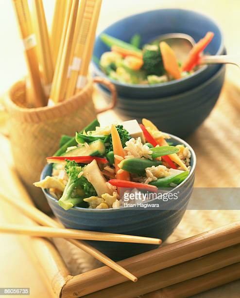vegetable stir fry over brown rice - stir fried stock pictures, royalty-free photos & images