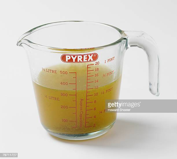 Vegetable stock in a glass jug, studio shot