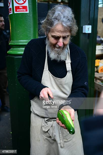 Vegetable vendor offering free sample of avocado at borough market
