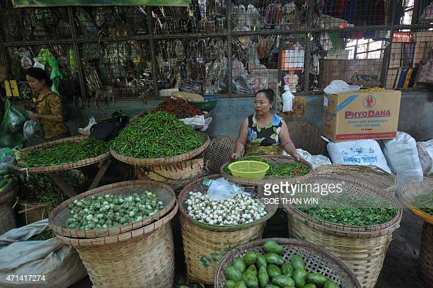 A vegetable vendor waits for customers at a wholesale market in Yangon on April 28 2015 AFP PHOTO / SOE THAN WIN