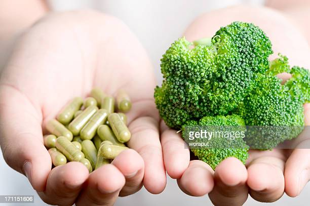 vegetable with medicine. - nutritional supplement stock pictures, royalty-free photos & images