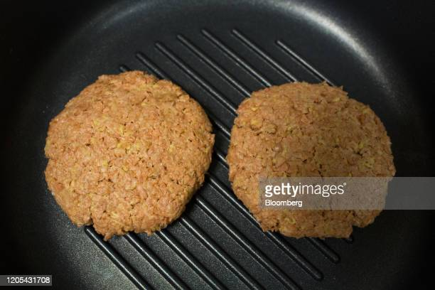 Vegetablebased burger patties sit on a griddle pan at the Greenwise LLC plant in Maloyaroslavets Russia on Friday Feb 28 2020 Awareness of meats...