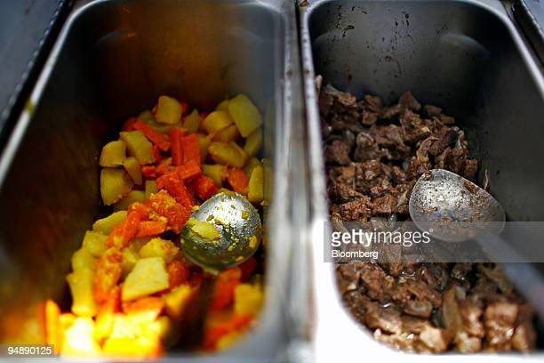 Vegetables and beef which are served with an Ethiopian bread called injera are pictured at Biasmir Abebe's food cart on on the corner of 15th Street...