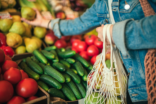 Vegetables and fruit in reusable bag on a farmers market, zero waste concept 1159376930