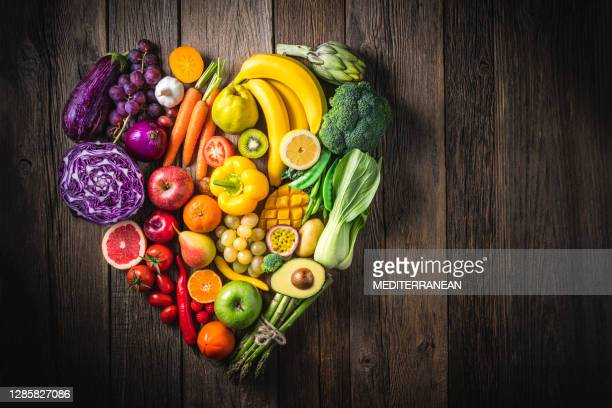 vegetables and fruit with heart shape as concept of cardiovascular health - vegetable stock pictures, royalty-free photos & images