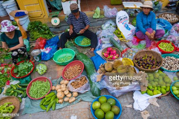 Vegetables and fruits are sold by local people at the small market in Hoi An