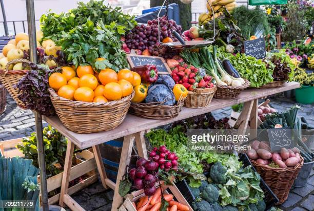 Vegetables And Fruits In Baskets At Market For Sale