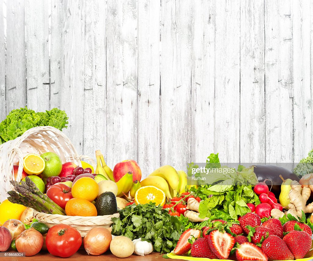 Vegetables and fruits over white wall background. : Stock Photo