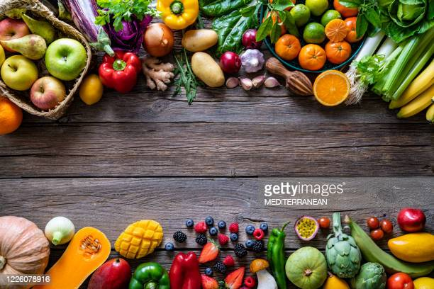 vegetables and fruits vegan food assorted arrangement on wood - freshness stock pictures, royalty-free photos & images