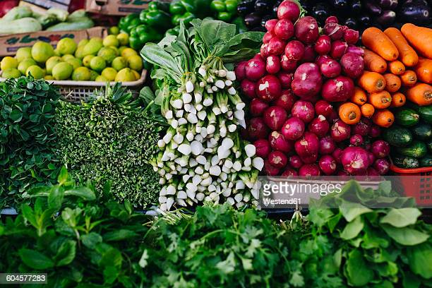 Vegetables and herbs at vegetable market