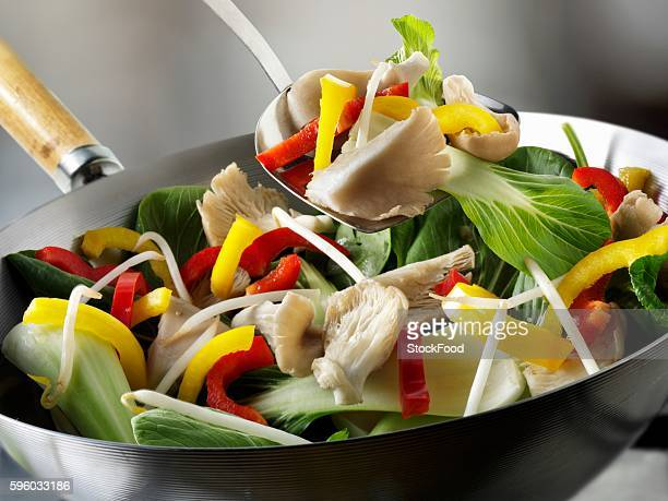 Vegetables and oyster mushrooms in wok