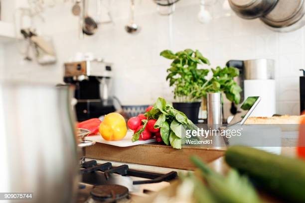 Vegetables and tablet on kitchen counter