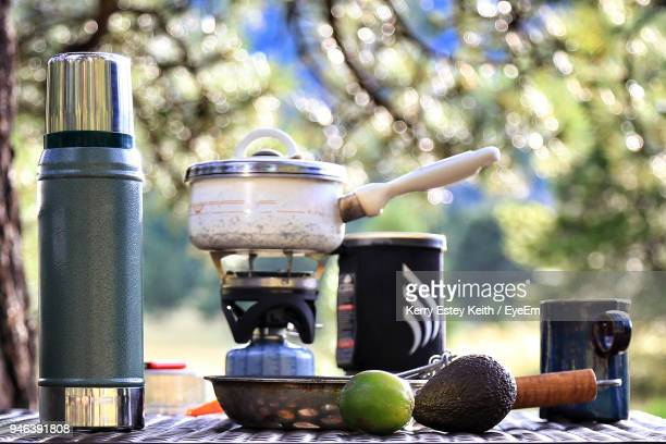vegetables and utensils on table at campsite - kerry estey keith stock photos and pictures