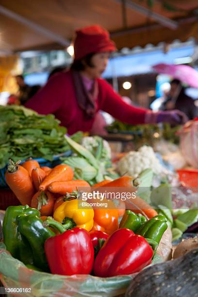 Vegetables are displayed at a market stall in Taipei, Taiwan, on Saturday, Jan. 7, 2012. Taiwan holds presidential elections on Jan. 14....