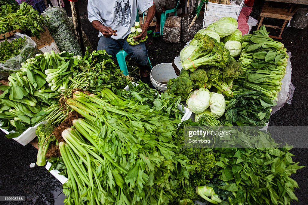Vegetables are displayed for sale at a stall at the Divisoria market in Manila, the Philippines, on Tuesday, Jan. 22, 2013. Philippine government bonds advanced on speculation the central bank will hold its benchmark interest rate at a record low at a meeting tomorrow, supporting demand for the nation's debt. Photographer: Julian Abram Wainwright/Bloomberg via Getty Images