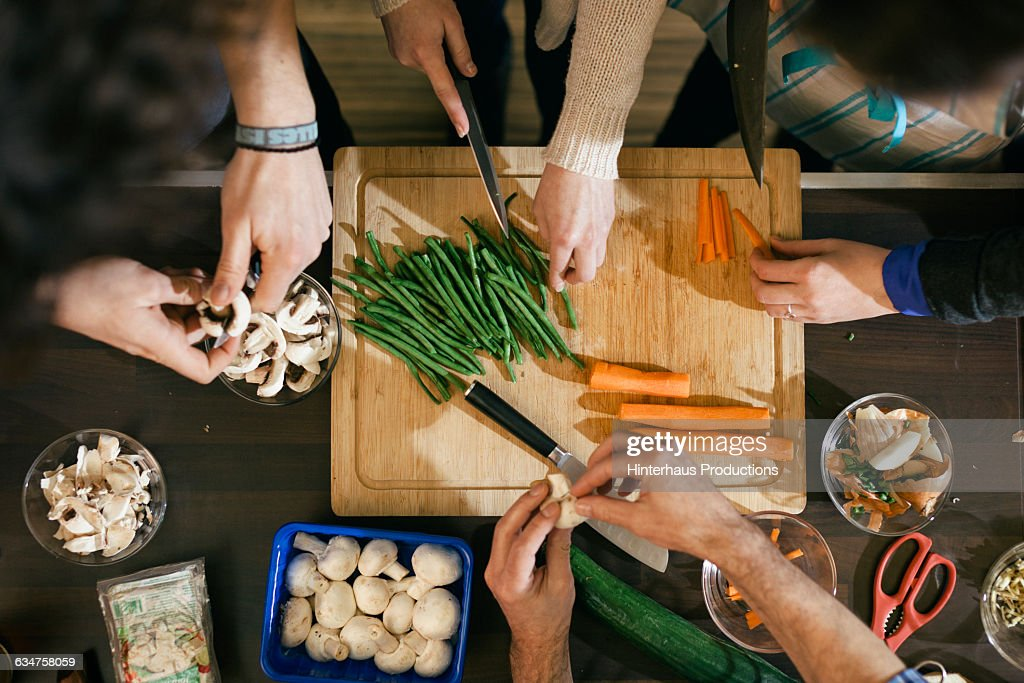 Vegetables being cut in cooking class : Stock Photo
