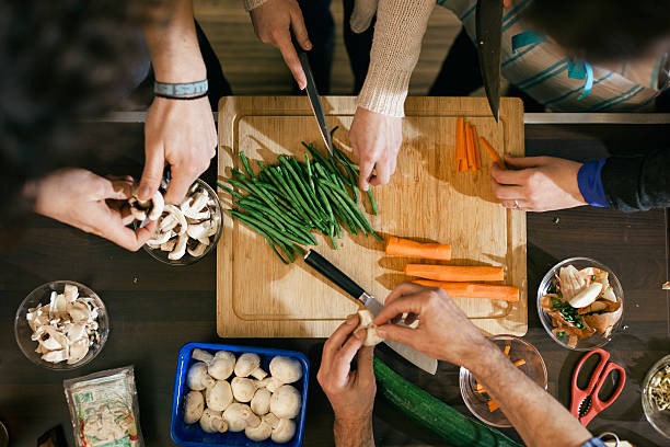 vegetables being cut in cooking class - preparation stock pictures, royalty-free photos & images