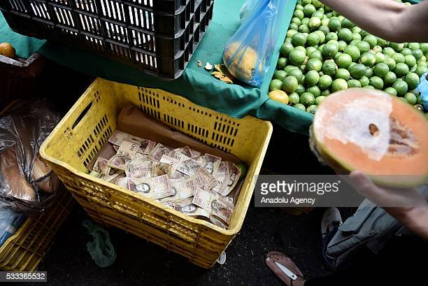A vegetables container used to put a large amount of bills of the sales of days in a local market in Caracas Venezuela on May 21 201 Venezuelans...