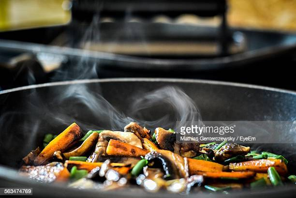 Vegetables Cooking In Saucepan At Kitchen