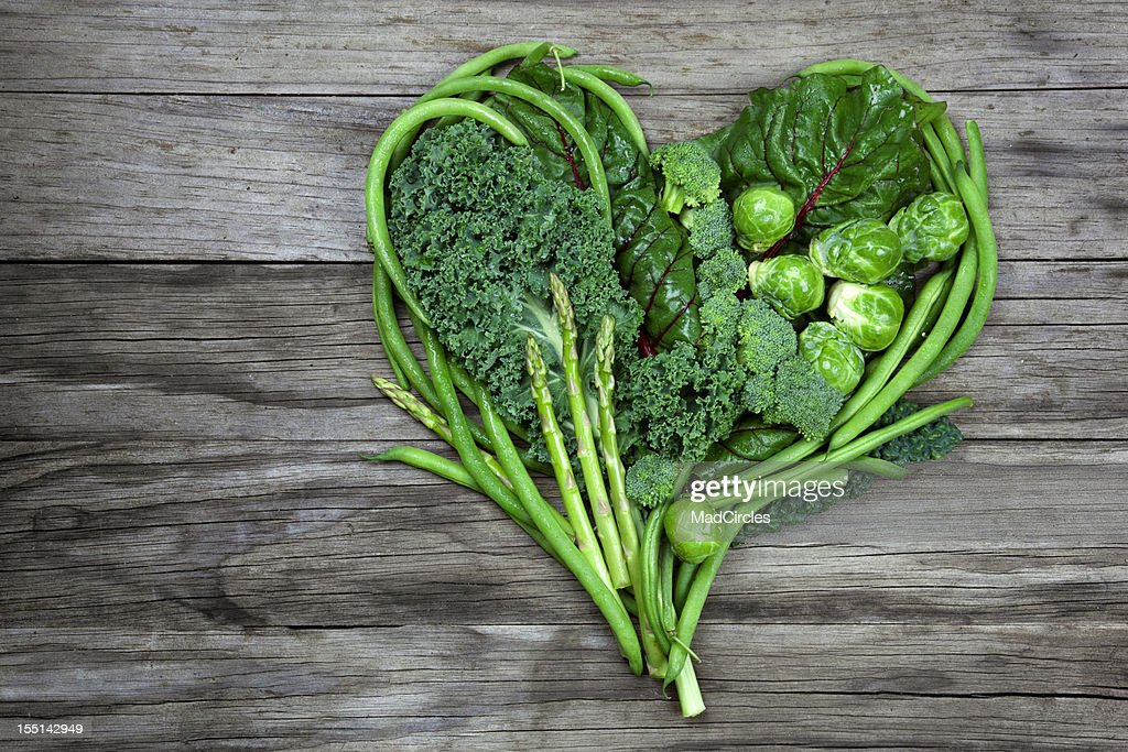 Vegetables - Green Heart Shape on Wood background : Stock Photo