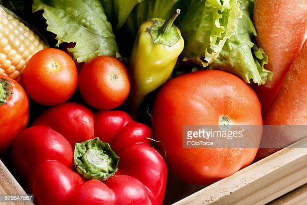 Vegetables in a wooden crate, studio shot