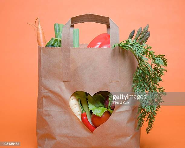 Vegetables in bag with heart symbol