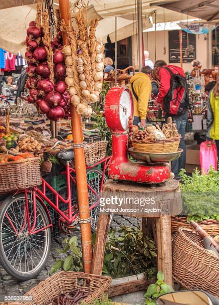 Vegetables In Basket On Weight Scale At Market Stall