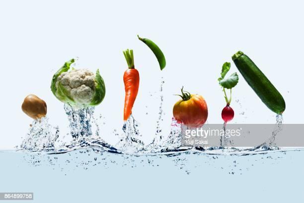 vegetables jump out from water . - leguminosa - fotografias e filmes do acervo