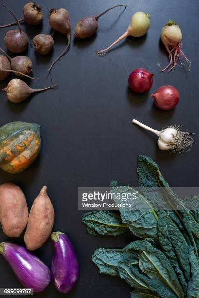 Vegetables on dark surface