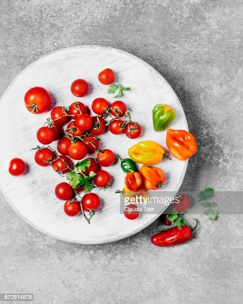 Vegetables (cherry tomatoes, and habanero chilli peppers)