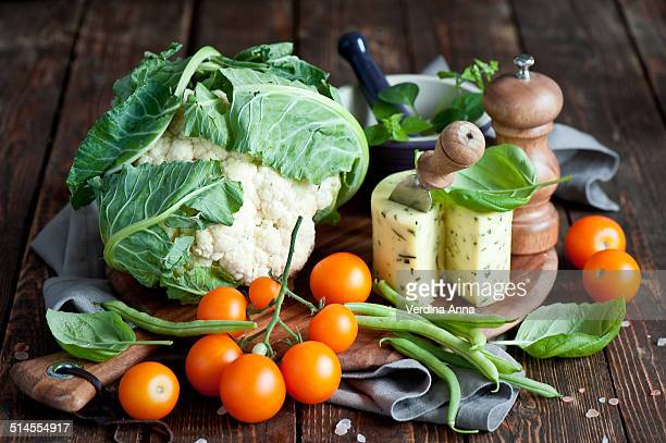 vegetablese and cheese - anna verdina stock photos and pictures