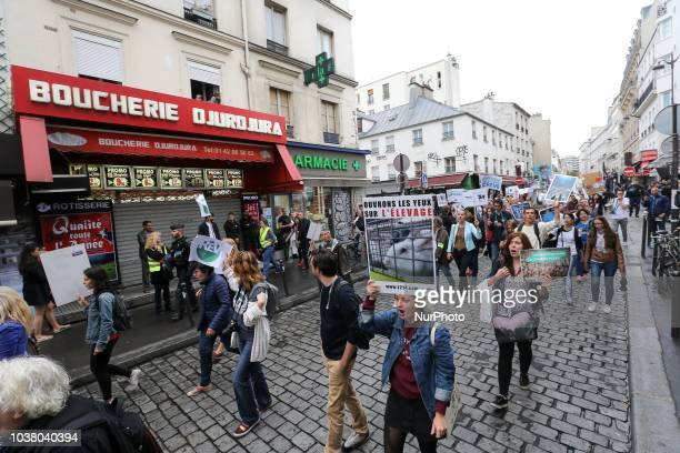 Vegetarian activists protest in front a butcher shop during the 18th Paris Veggie Pride on September 22 2018 in Paris The Paris Veggie Pride is held...