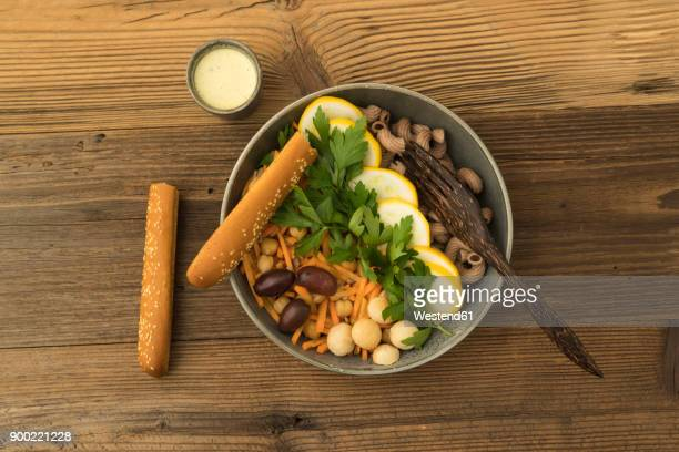 vegetarian and vegan salad with whole grain pasta, vegetables, chickpeas and yogurt sauce - flat leaf parsley stock pictures, royalty-free photos & images