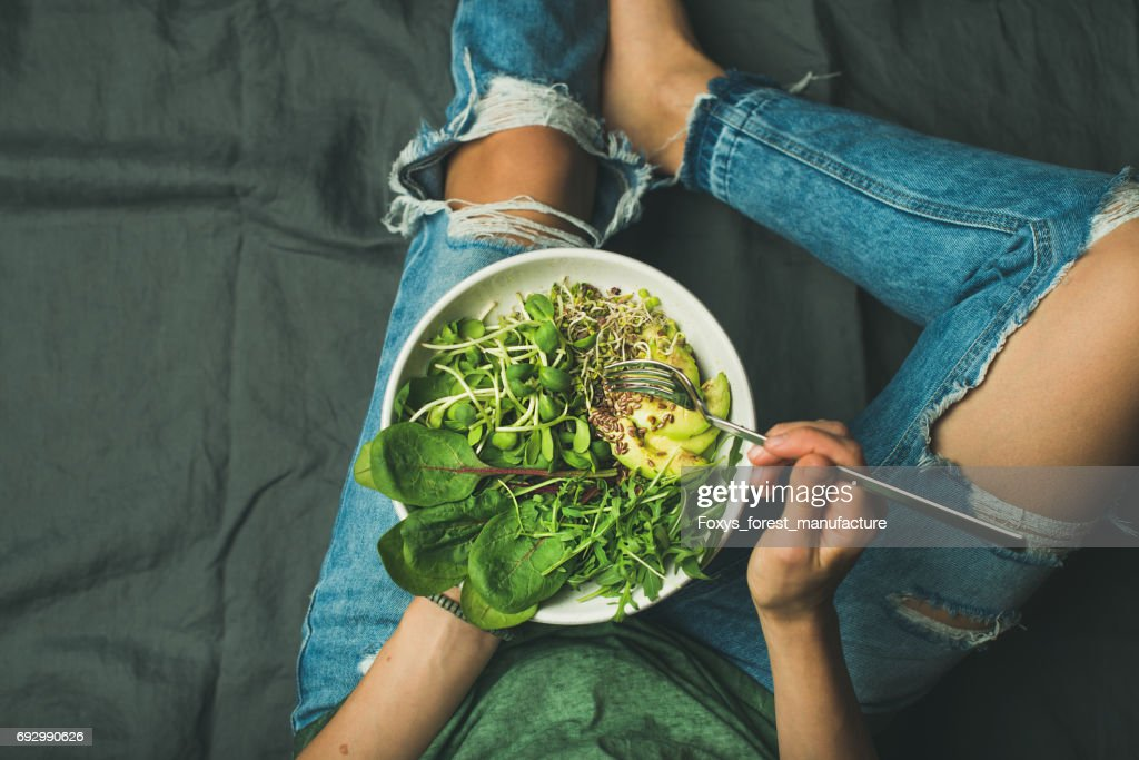 Vegetarian breakfast bowl with spinach, arugula, avocado, seeds and sprouts : Stock Photo