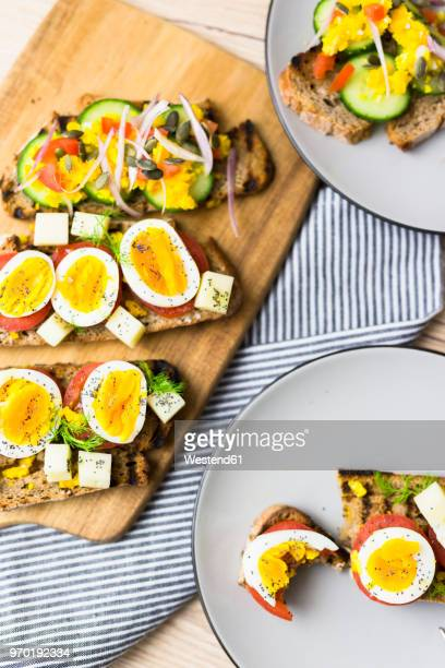 Vegetarian breakfast with bread, eggs and tomato slices and cucumber slices