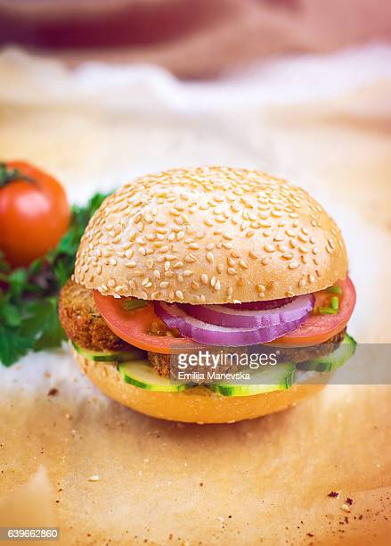 Vegetarian burger with Chickpeas, tomato, cucumber and onions