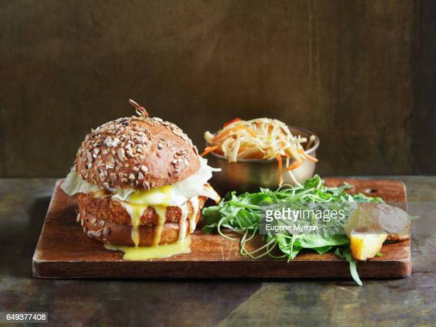 vegetarian burger with falafel and coleslaw - cheese sauce stock photos and pictures