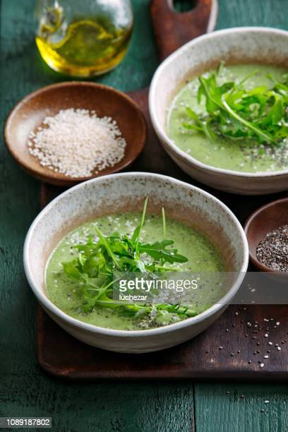 vegetarian creamy spinach soup - arugula stock pictures, royalty-free photos & images