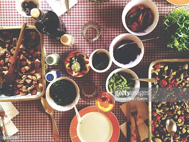 vegetarian food on table - danielle reid stock pictures, royalty-free photos & images